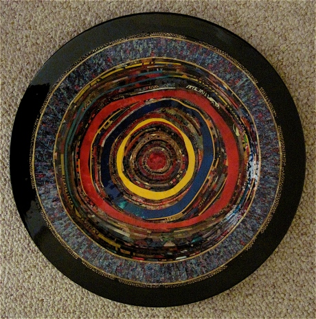 "Exultate Jubilate. Mosaic paper collage on wooden disc, finished with multiple coats polyurethane varnish. Hanger fixed on back. 13"" diameter. $325.00."