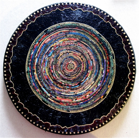 "Minerva. Mosaic paper collage on wood, finished with multiple coats polyurethane varnish. Hanger fixed on back. 11"" diameter. $225.00."