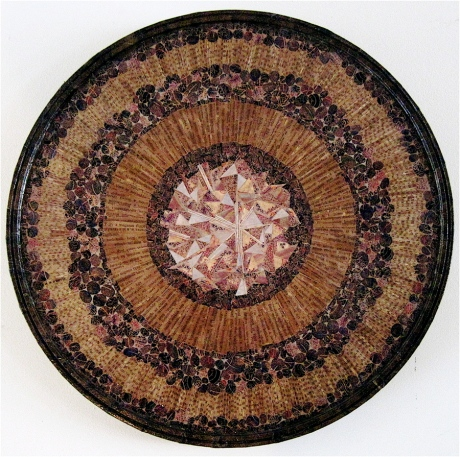 "Octavia. Mosaic paper collage on wood, finished with multiple coats polyurethane varnish. Hanger fixed on back. 18.5"" diameter. $725.00."