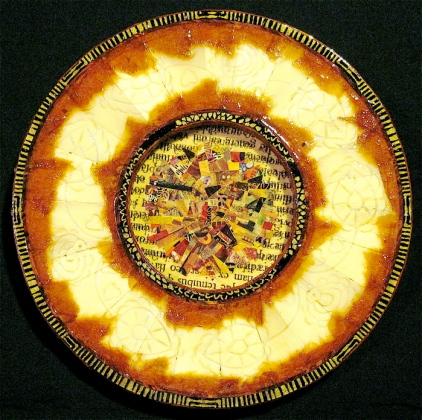 "Sunburst. Mosaic collage on wood, carved bakelite, finished with multiple coats polyurethane varnish. Hanger fixed on back. 6"" diameter. $68.00."