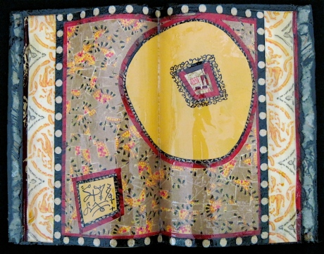 "Sun Child. Mosaic paper collage on altered book, finished with multiple coats polyurethane varnish. Hanger fixed on back. 7.5"" w x 5.75"" h. $140.00."