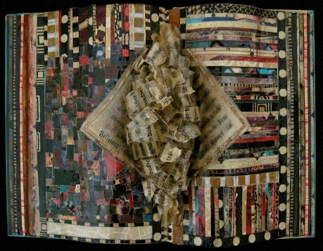 "Winged Messenger. Mosaic paper collage, cut, shaped paper, on altered book, finished with multiple coats polyurethane varnish. Hanger fixed on back. 6.75"" w x 4.75"" h. $145.00."